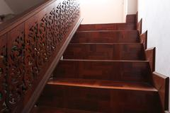 wood staircase with parquet floor - stock photo