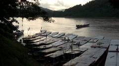 Long-tail boats at the Mekong River in Luang Prabang, Laos, Asia Stock Footage
