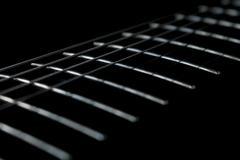 Guitar fretboard close up - stock photo
