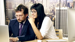 Woman harrassing sexually coworker in office Stock Footage