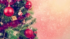 Snowy red christmas on tree background with red balls and snowflakes Stock Footage