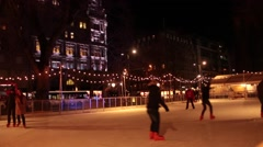 Ice skaters at an outdoor ice rink Stock Footage