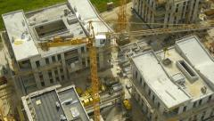 Stock Video Footage of Aerial HD: Follow Crane and Construction Site