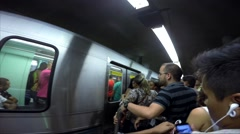 Workers trying to enter in a busy train in Rush Hour on Se Station Stock Footage