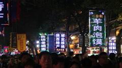 Night scene of Xian Huimin Street,a famous Muslim cuisine street Stock Footage