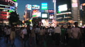 Shibuya, Tokyo, Japan. Consumerism. Neon. Night. People, crowd. Footage