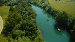 Stock Video Footage of Aerial HD: Pursuit Over 2 Canoes on the River