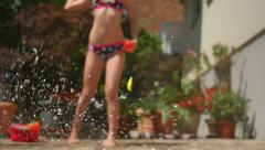HD Slow-Mo: Teen Girl throwing a red water balloon Stock Footage