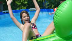 HD Slow-Mo: Girl fall of the Inflatable Cushion - stock footage