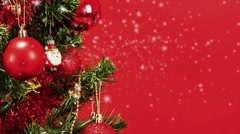 Abstract snow background with detail of decorated christmas tree with red balls Stock Footage
