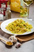Tagliatelle with chicken curry, leek and garlic, home made, bio garlic, fresh Stock Photos