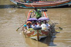 Stock Photo of yangon, myanmar - november 22, 2014: several unidentified people take the boa
