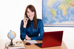 Stock Photo of travel agency employee at work