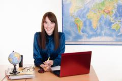 shy girl in office of the travel agency - stock photo