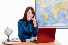 travel agency employee talking on the phone - stock photo