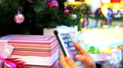 Womans Hand uses phone and taking photo of Christmas tree by smartphone. HD. Stock Footage