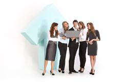 Group of young employees at a large arrow Stock Photos