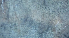 Closeup of running water background over blue rock. Stock Footage