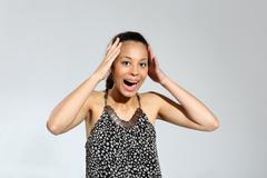 Stock Photo of Sale, woman shopping screaming.