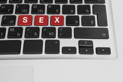 online porn concept. sex buttons on the computer keyboard - stock photo