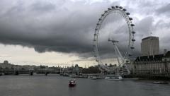 Timelapse of the London eye under dark clouds Stock Footage