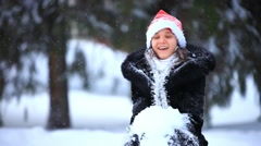 Happy smiling woman in Christmas cap having fun outdoors and enjoys the snow. HD Stock Footage