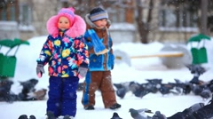 Russia. Siberia. 12 december 2014. Children playing with doves in the city Stock Footage