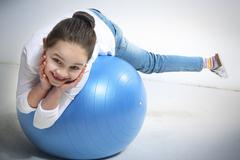 Little girl posing with a ball - stock photo