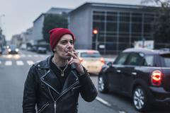 punk guy posing in the city streets - stock photo