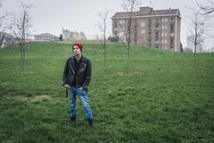 punk guy posing in a city park - stock photo