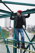 Punk guy standing on a bridge Stock Photos
