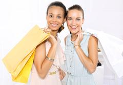 Stock Photo of Friends of paper shopping bags