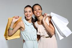 Two woman with paper shopping bags  Stock Photos