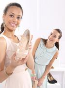 Stock Photo of Summer shoes, a woman in a shoe store