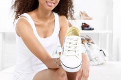 Sport shoes, sneakers girl buys  - stock photo