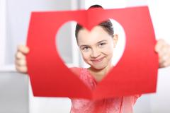 Girl with a Valentine's card - stock photo
