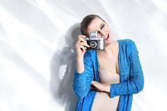 Fashion woman taking photo with vintage camera - stock photo