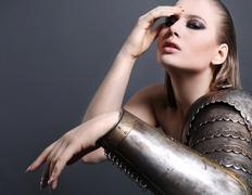 Beautiful girl in armor Stock Photos