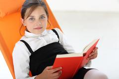 Interesting reading - girl reading a book  - stock photo