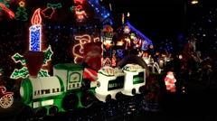 Christmas decorations and lights on house at night - stock footage