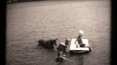 Family estate in the depression, lake float playing Stock Footage