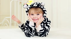 Cute three-year-old girl in the zebra costume Stock Footage