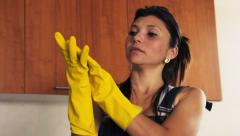 Young Hispanic Woman With Yellow Latex Gloves Cleaning Home Stock Footage