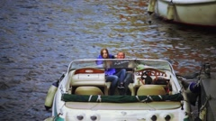 Couple in a motor boat, Saint Petersburg, Russia Stock Footage