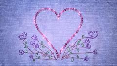 Sequin love heart and embroidered flowers. Last 3 seconds is a loop. - stock footage