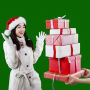 Stock Photo of attractive young girl receive presents