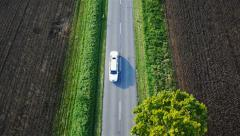Limousine top view shot, White limousine passing by, countryside Stock Footage