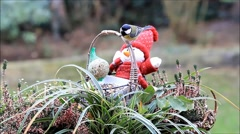 Basket with little doll and food for birds Stock Footage