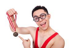 Funny wrestler with winners gold medal Kuvituskuvat