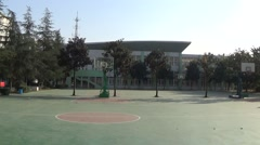Empty basketball playground in a high school Stock Footage